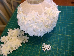 The awesometastic bridal blog paper flower lanterns step 2 hot glue a pom pom ball into the center of each fake flower mightylinksfo