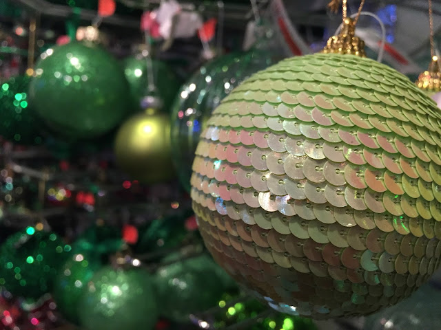 Green baubles in the Christmas shop