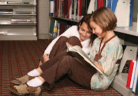 montessori community recommended reading lists upper elementary girls reading a book