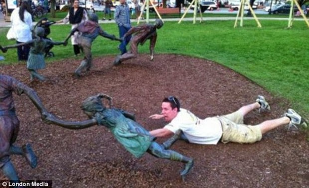 Tourist Posing Inappropriately with Statues 8