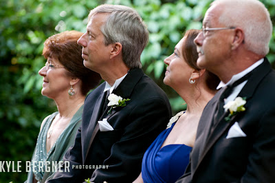 Parents watching the ceremony in the garden at Chase Court