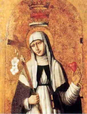 La santa con habitos de monja, un corazon en una mano y lirios y crucifijo en la otra