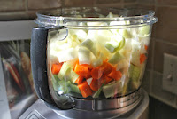 Onions, carrots, fennel, and leeks in food processor