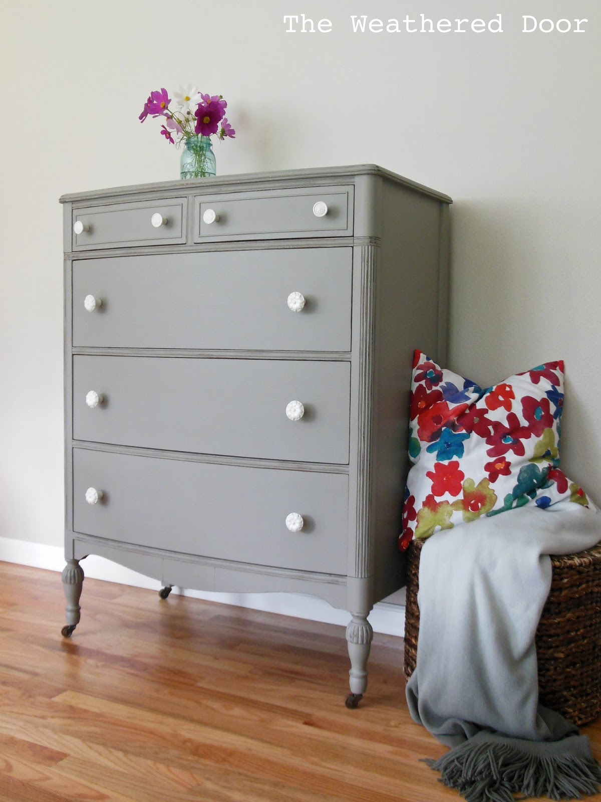 A Distressed Elephant Grey Dresser With White Knobs The Weathered Door