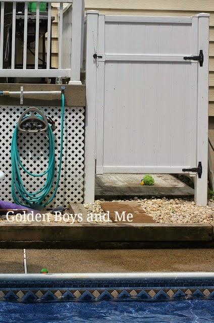 DIY outdoor shower using PVC fencing-www.goldenboyandme.com