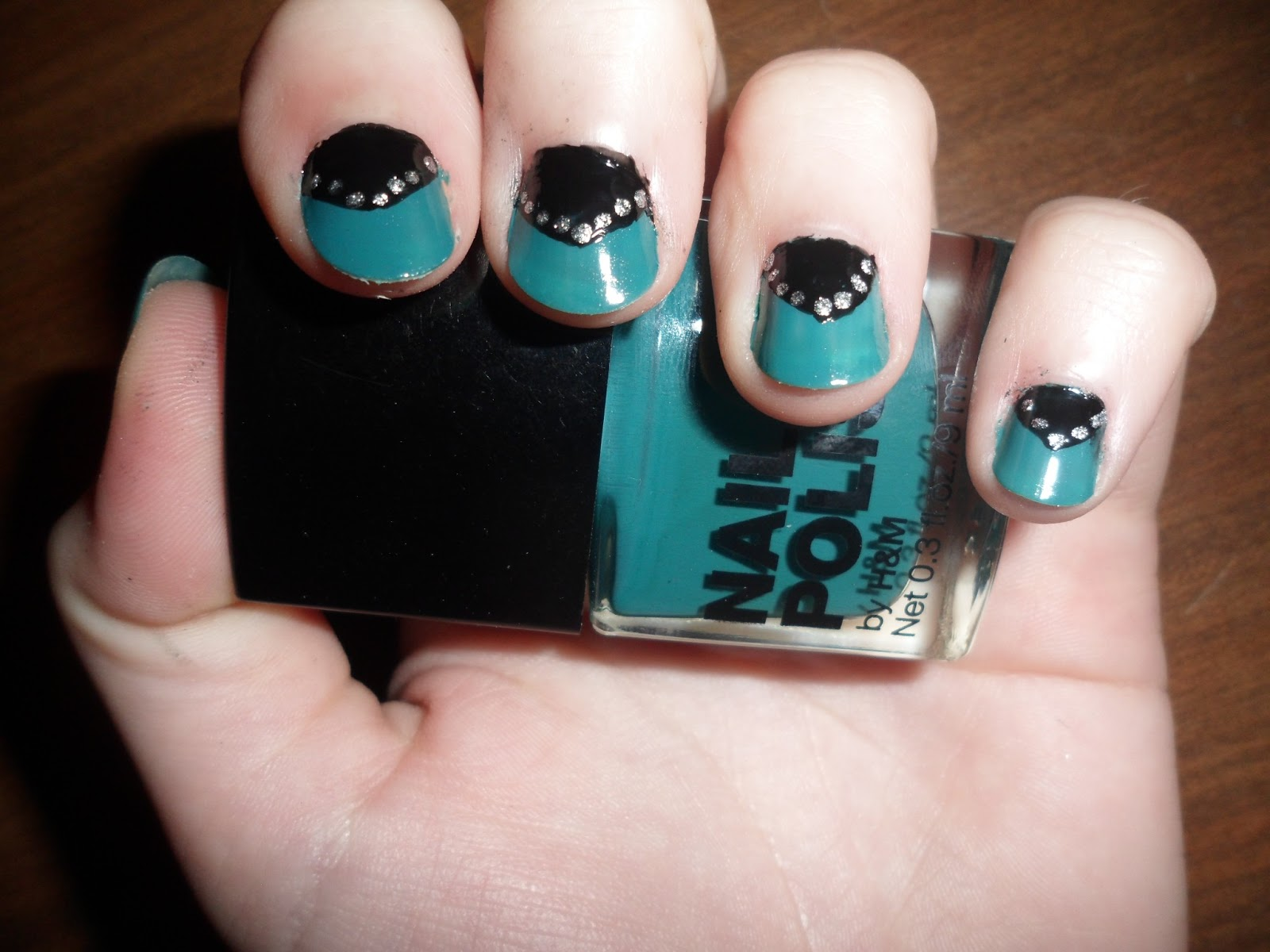 SophieClaira: Blue, black and silver nails.