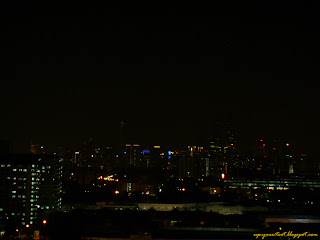 Lights out on KLCC Twin Towers and KL Tower during Earth Hour 2012