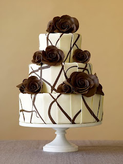 A modern wedding cake with chocolate roses.