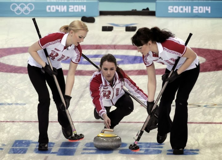 Anna Sidorova, Alexandra Saitova, and Ekaterina Galkina in action at the 2014 Sochi Winter Olympics