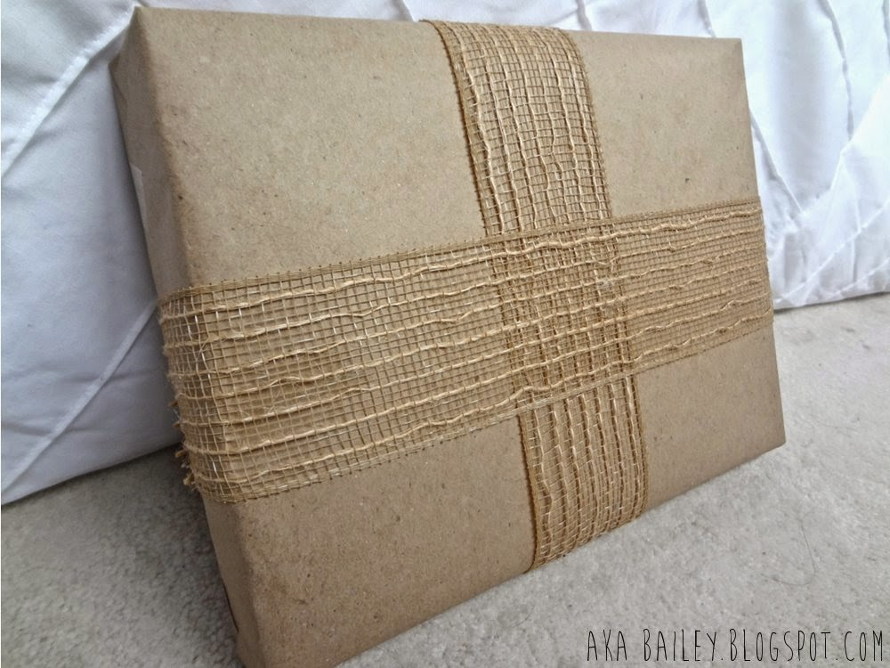 Brown paper gift wrap wrapped with burlap ribbon