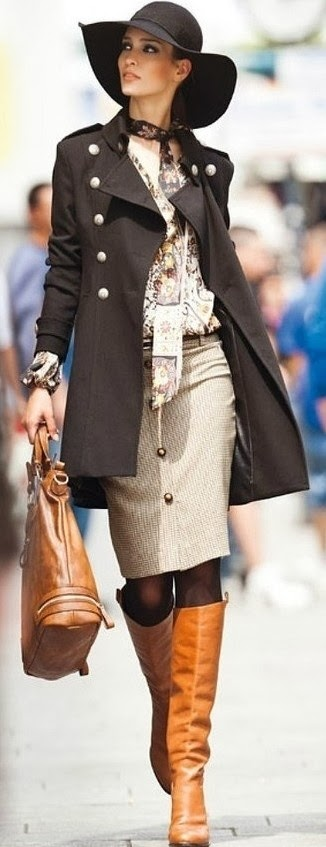 A beautiful black coat and brown boot plus bag