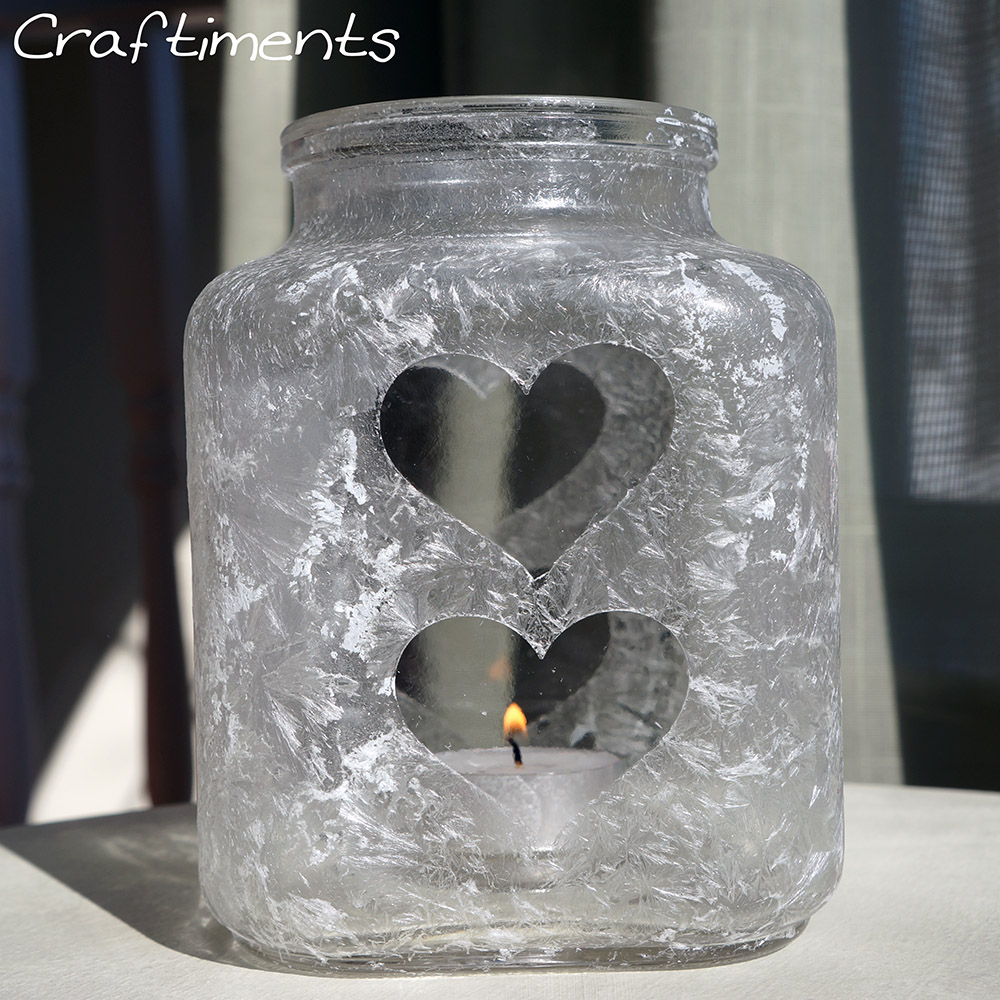 Craftiments:  Epsom salt luminary with made using heart stickers as a mask