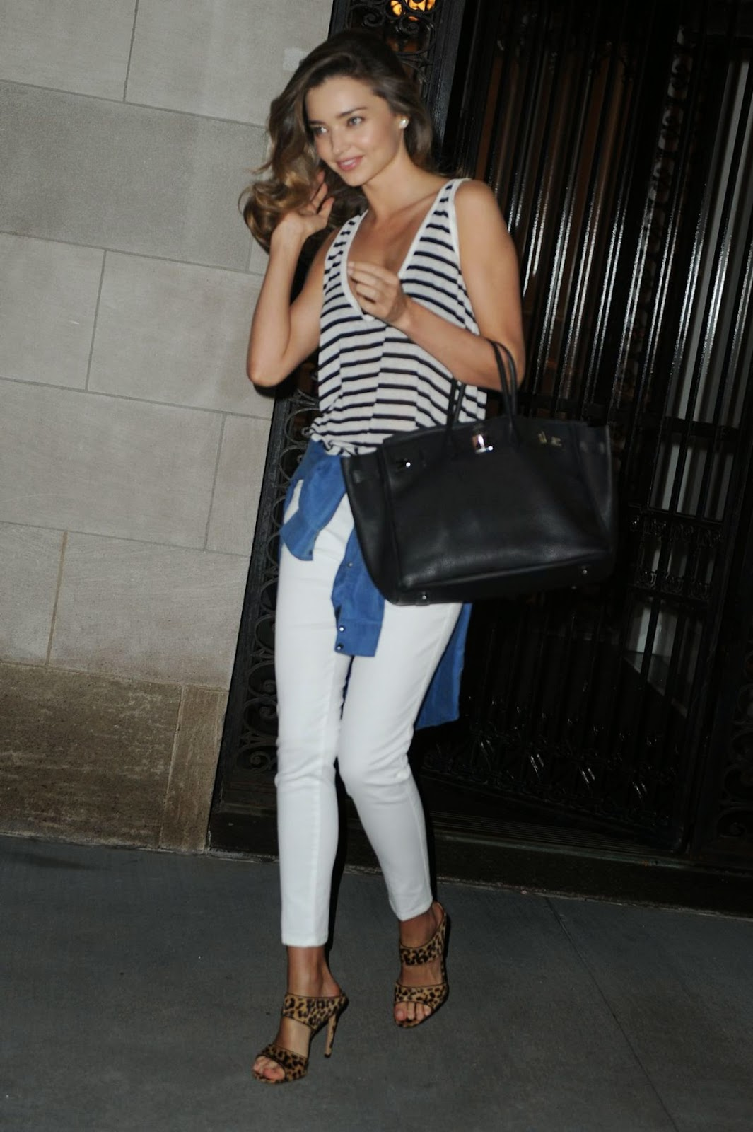 Miranda Kerr in leopard print heels at the Mandarin Oriental Hotel in NYC
