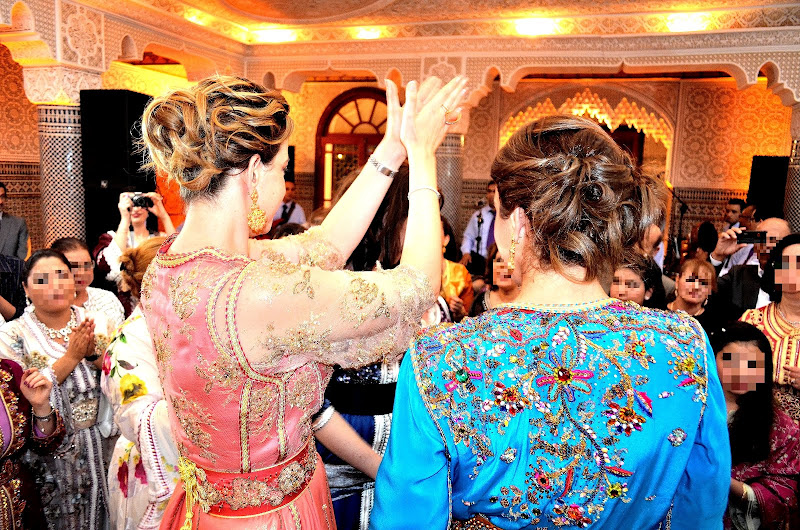 colorful moroccan caftans on wedding party