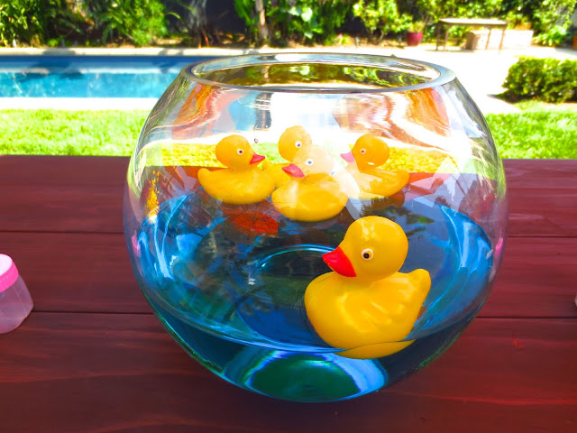 Rubber duckies in a fish bowl creative centerpiece baby shower