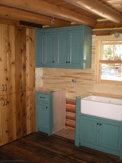 Custom cabinets, reclaimed Oak floor http://huismanconcepts.com/