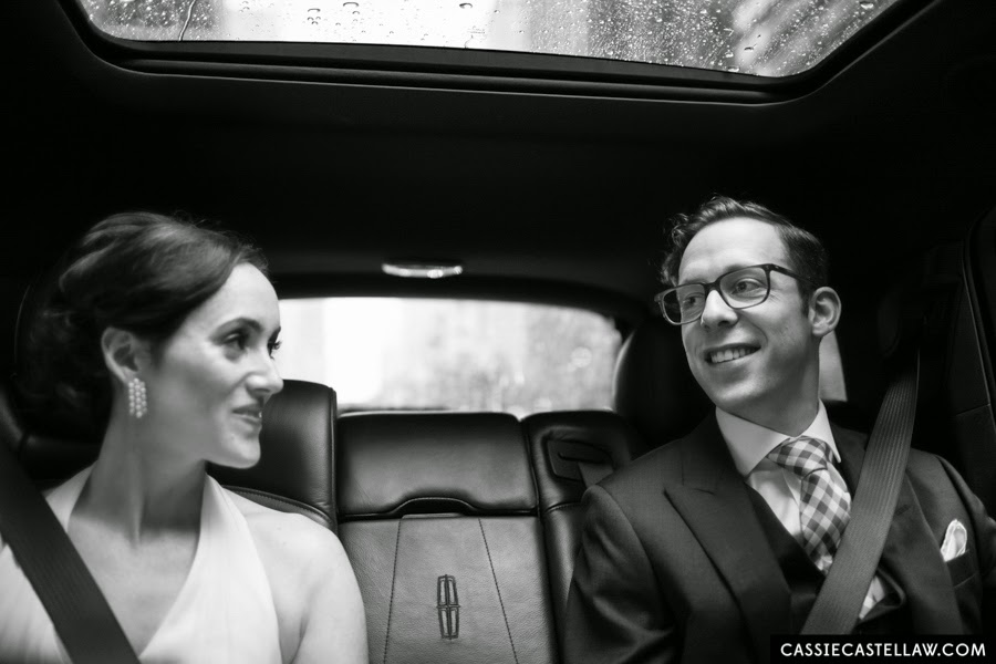 Black and white candid of Bride and Groom in Lincoln MKX on the way to their wedding. NYC Lifestyle wedding photography by Cassie Castellaw. www.cassiecastellaw.com