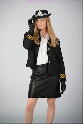 Hot Blonde Sexy Police Woman in Leather Skirts and Gloves