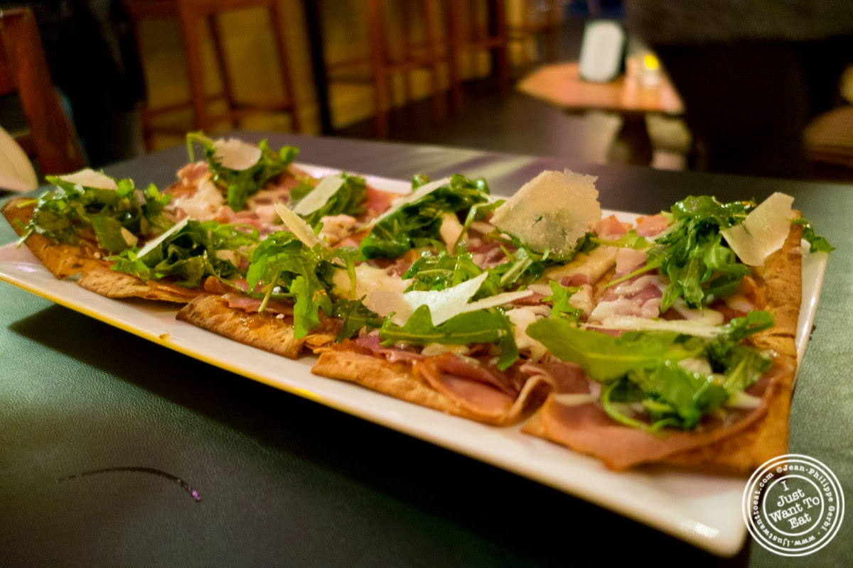 image of Prosciutto and fig flatbread at MASQ New Orleans inspired cuisine in NYC, New York