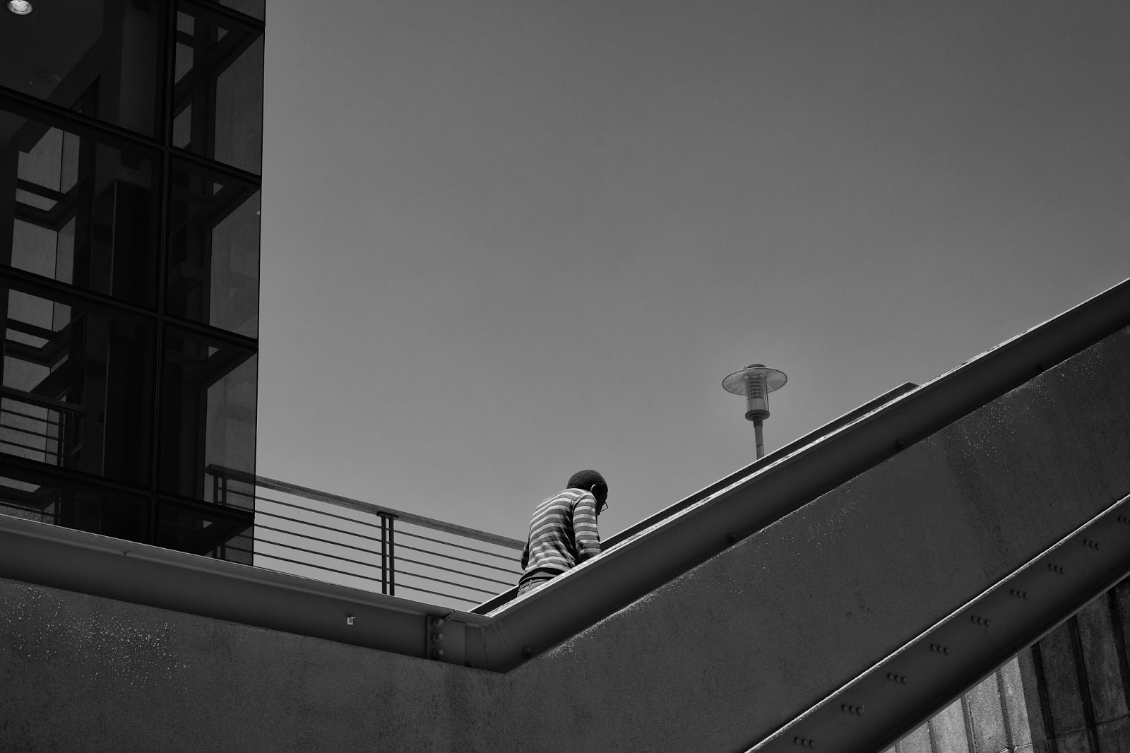 A man climbs the steps outside the Cape Town train station