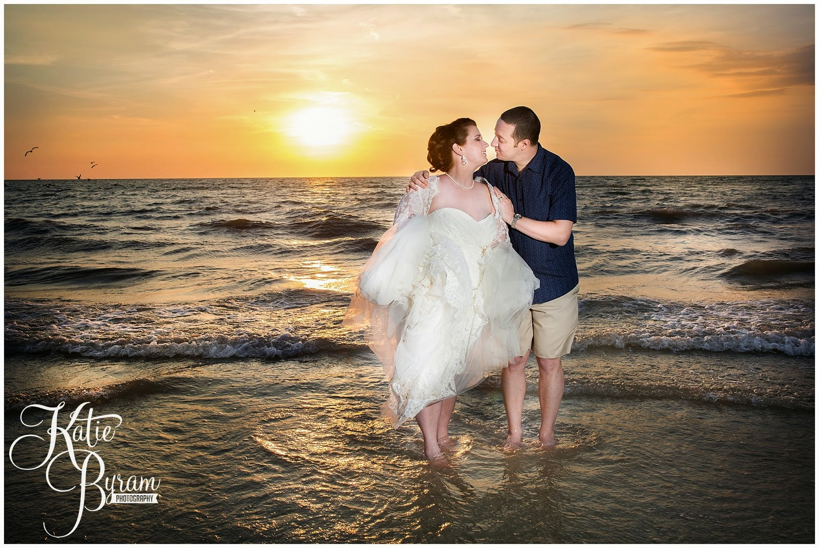 bride and groom in the sea, nautical wedding, beach wedding theme, destination wedding, clearwater beach wedding, hilton clearwater beach wedding, katie byram photography, florida wedding