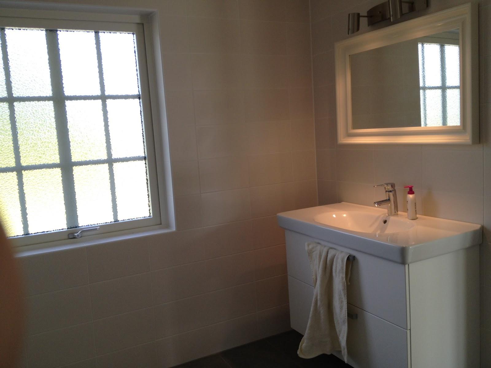 Husbygget: badrum och tvättstuga