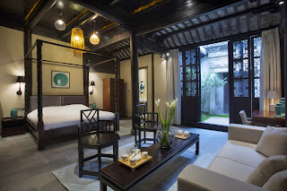 traditional chinese bedroom setting highlighted by lighting fixtures