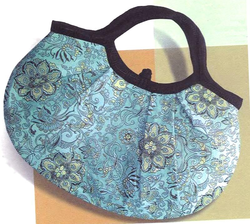 Простая овальная сумка с застежкой-узелком