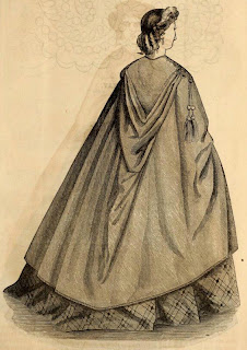 cloak with long pointy hood