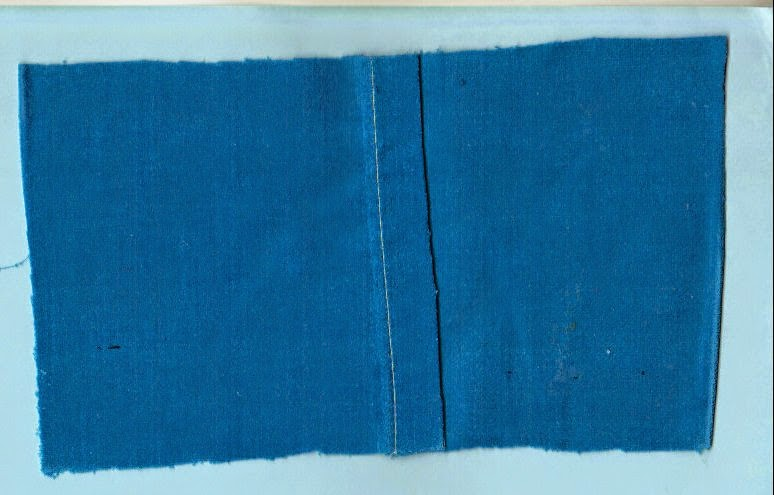 Open fabric to one layer and press on the right side