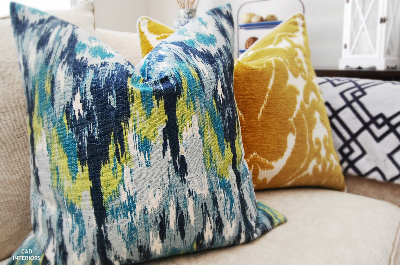 CAD INTERIORS pillows ikat fabric eclectic indigo blue yellow green teal turquoise lime transitional interior design decorating home accessories