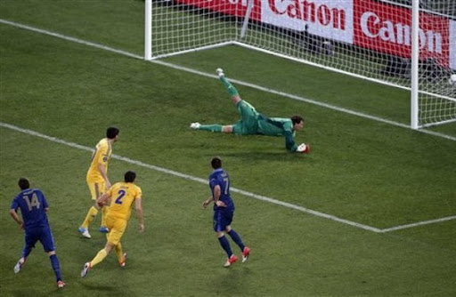 France player Jérémy Ménez scores the opening goal past Ukraine goalkeeper Andriy Pyatov