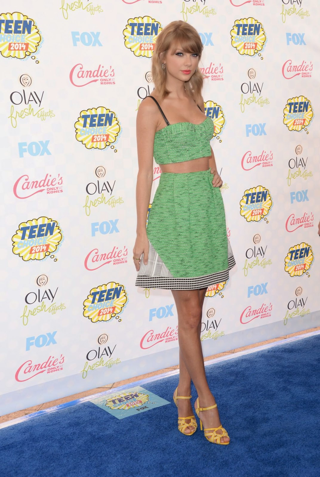Taylor Swift in a tweed cropped top and skirt at the 2014 Teen Choice Awards