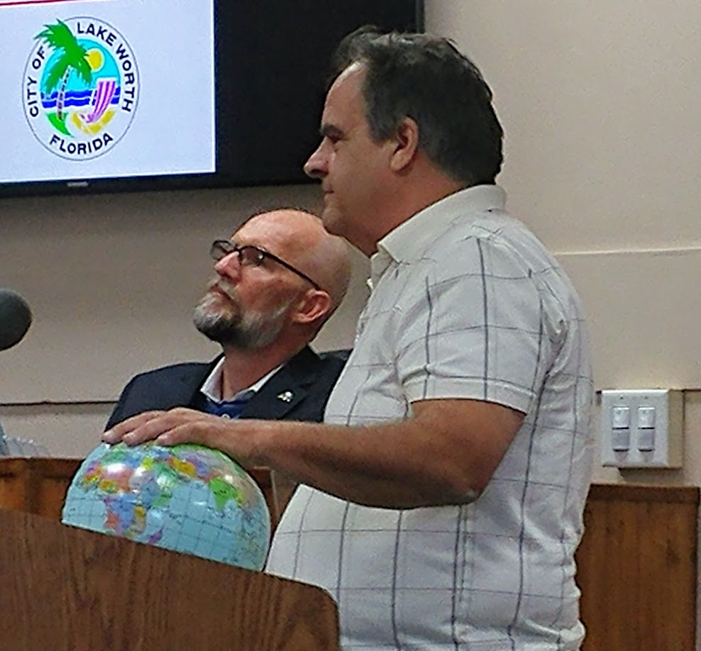 Earth Day is Saturday. Click Mr. Brian Kirsch with his Planet Earth at City Commission: