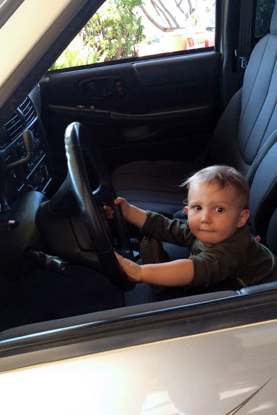 Reef Loves to 'drive' Opa's new used truck.