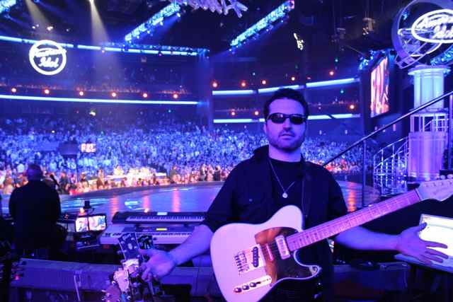 American Idol Guitar Player Tony Pulizzi poses in front of the AI Finale crowd