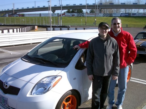 My dad and me with my 2007 Yaris
