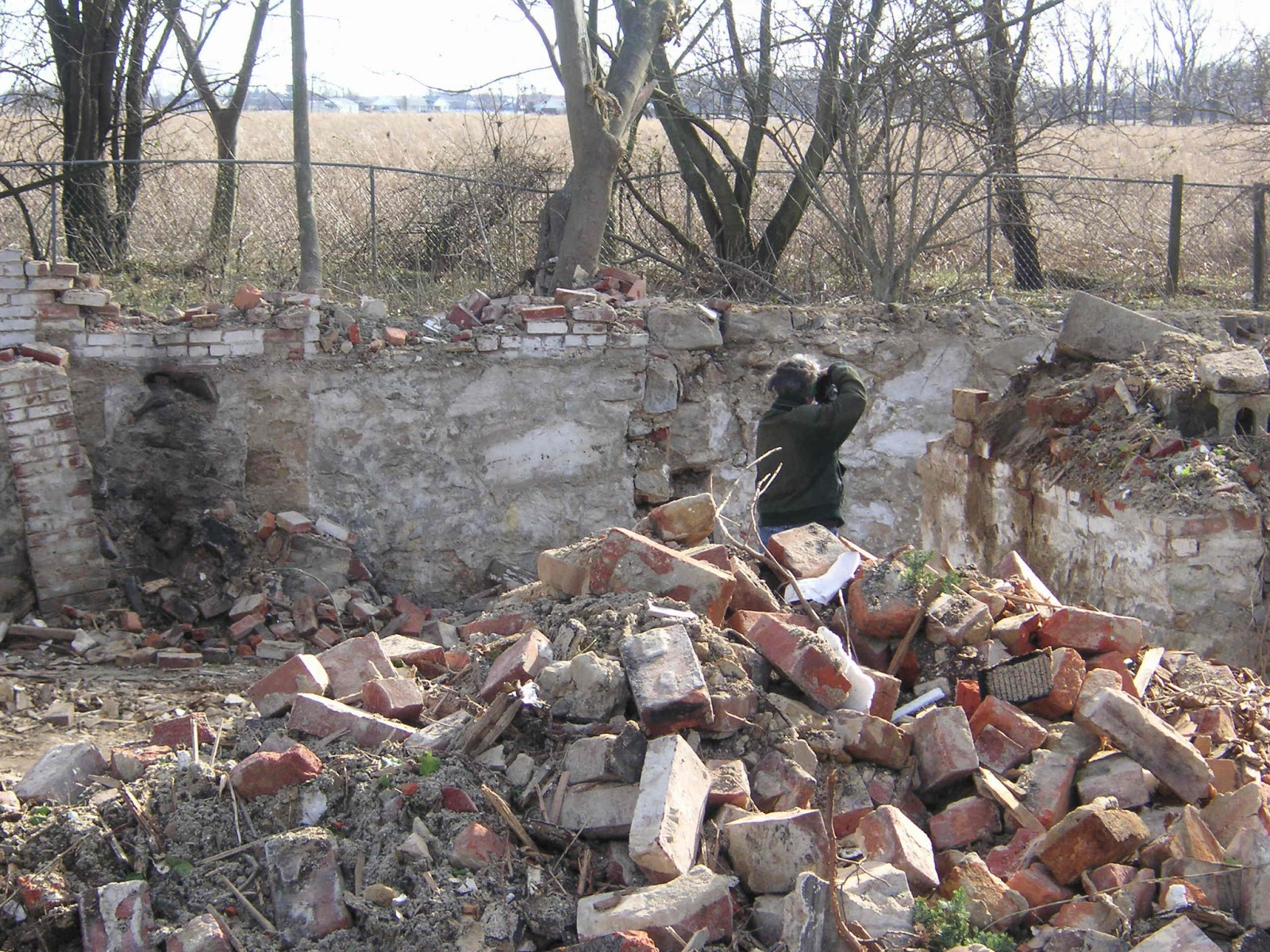 we dug and clawed enough debris away to discover a fallen brick relieving arch tell tale of an early chimney support after exposing the limits of the