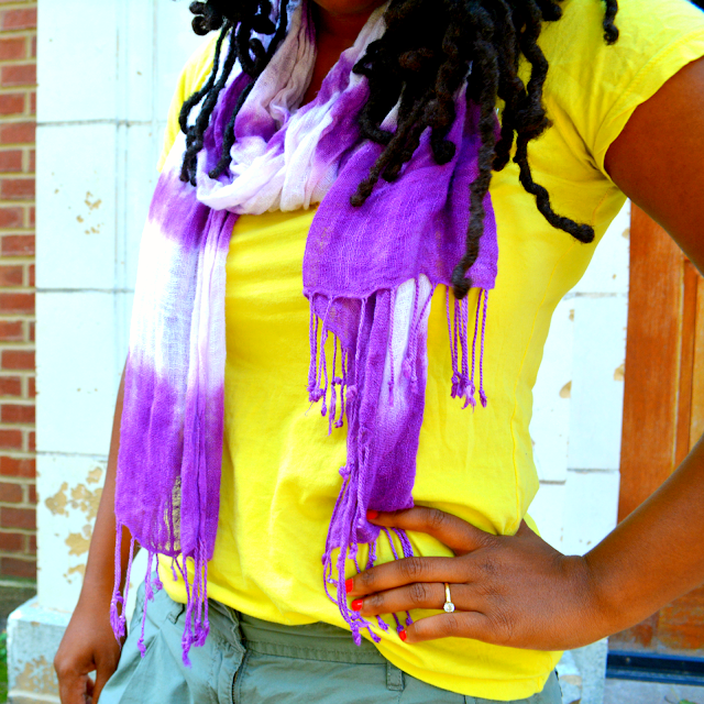 neon tee worn with a tie dye scarf