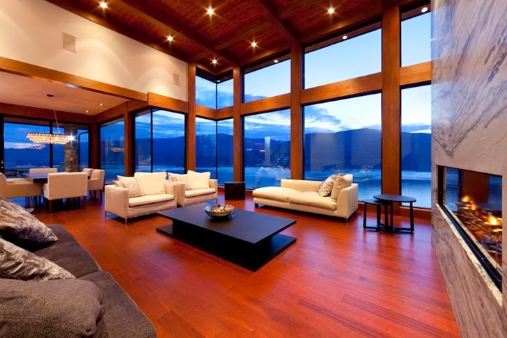 Living room in Contemporary style lake house in Canada