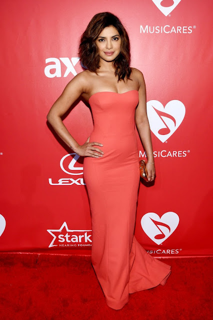 Priyanka Chopra in Orange Gown 2015 MusiCares Person Of The Year Gala Honoring Bob Dylan Los Angeles+3.jpg