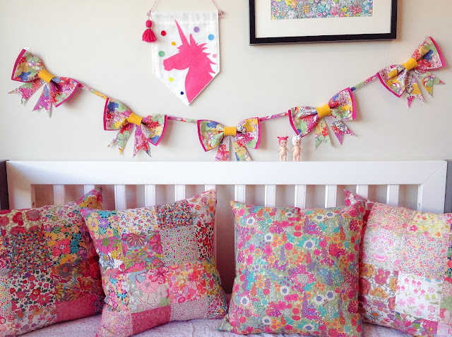 Display of Four Liberty Cushions and Bow Garland