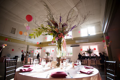 pink linens, balloons at wedding, wedding design, event design, shades of pink, large centerpiece, tall centerpiece design