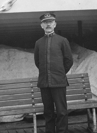 Black-and-white negative, 4 x 5 inches. Alexander Ryan is standing looking at the camera with his hands behind his back in his crew uniform on the deck of a ship, possibly Manoa (built 1913; merchant vessel).