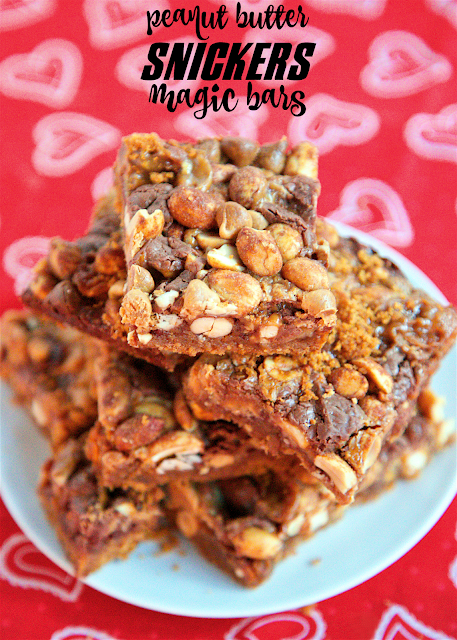 Peanut Butter Snickers Magic Bars - snickers baking bites, peanut butter chips, honey roasted peanuts on top of a graham cracker crust and drowned in sweetened condensed milk. SO easy to make and SOOO delicious! Everyone raved about them!