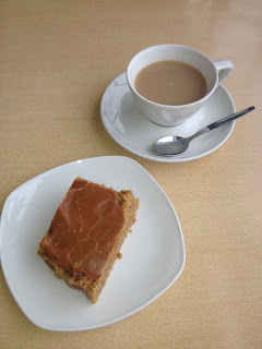 Cup of tea with a hunk of caramel-covered flapjack