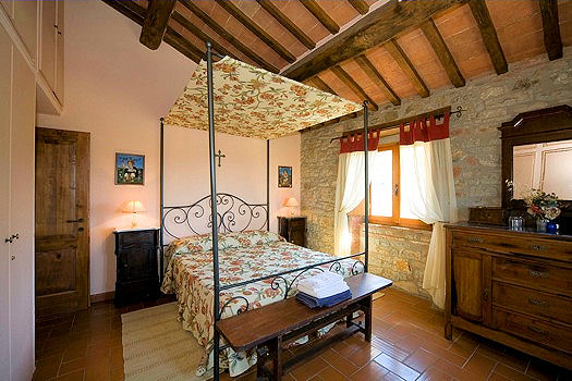 One of ten rustic bedrooms at the Tenuta di Poggiolame. Photo: Courtesy of Arte Umbria. Unauthorized use is prohibited.
