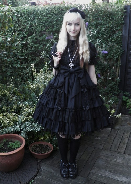 Gothic clothing has gloomy prints on dark background in modern times