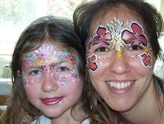 Mom and daughter with faces painted with flowers