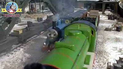 Little blue number 1 train Thomas with Annie and Clarabel coaches puffed into freight shipping docks